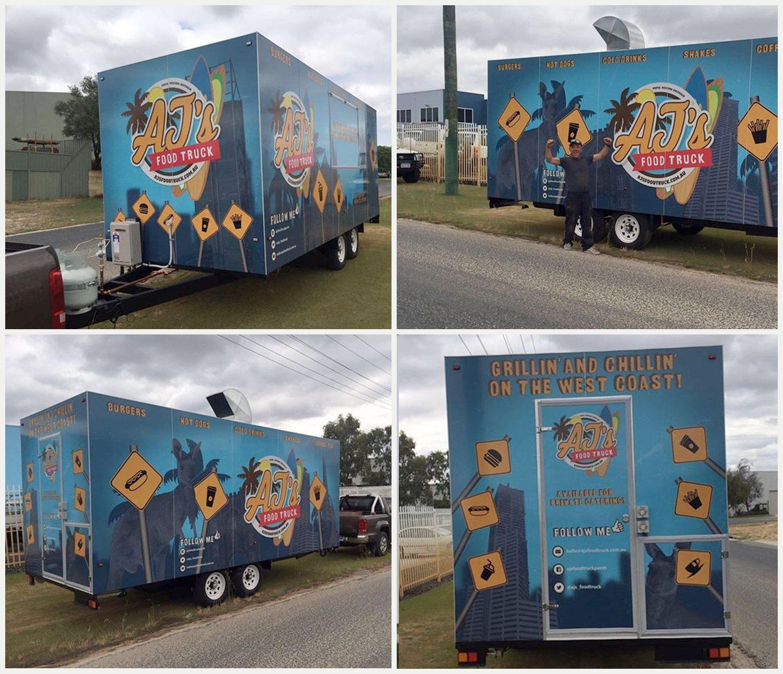 AJ's Food Truck with happy customer beside it