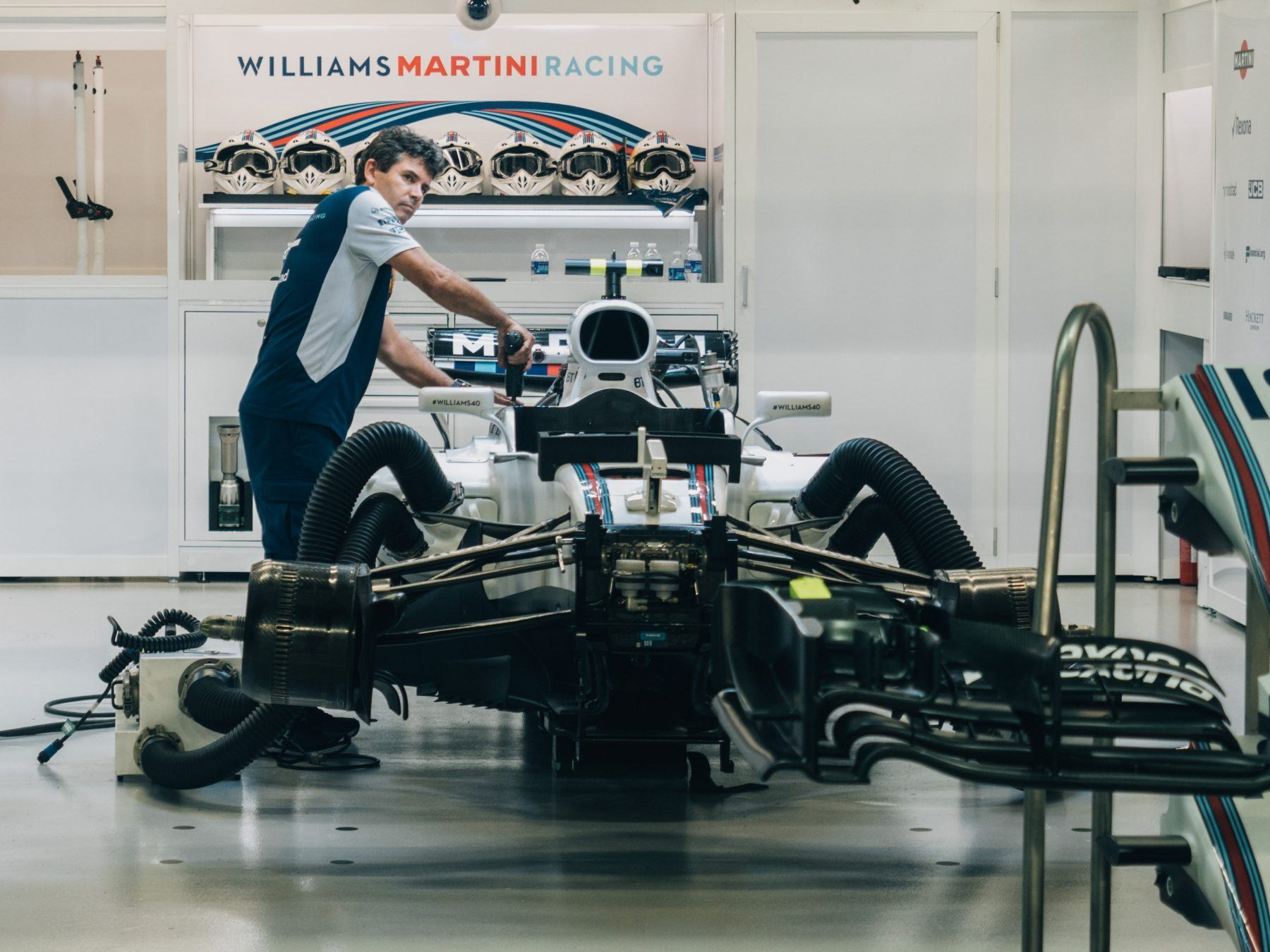 mechanic working on f1 car