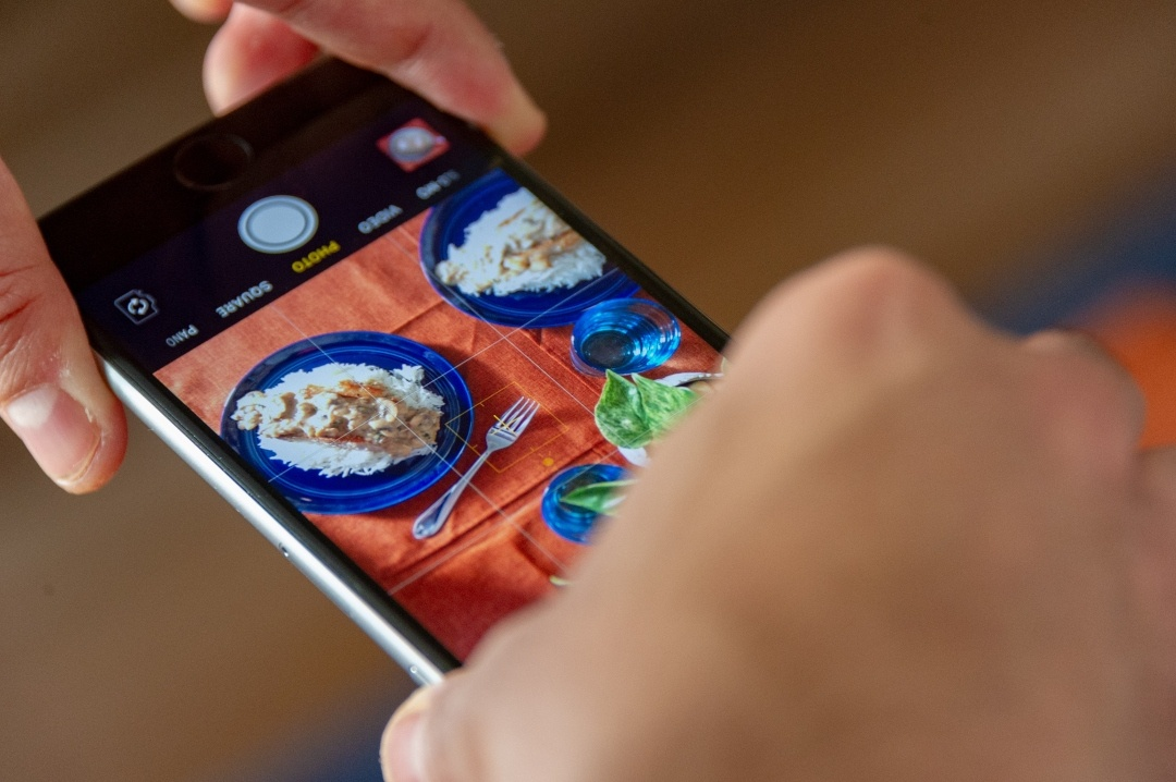 Taking a photo of food on phone